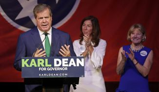 Karl Dean thanks supporters at a victory party after winning the Democratic nomination for Tennessee governor, Thursday, Aug. 2, 2018, in Nashville, Tenn. With Dean are his wife, Anne Davis, right, and Leslie Dashiell, center, mother-in-law of Dean's son, Rascoe. (AP Photo/Mark Humphrey)