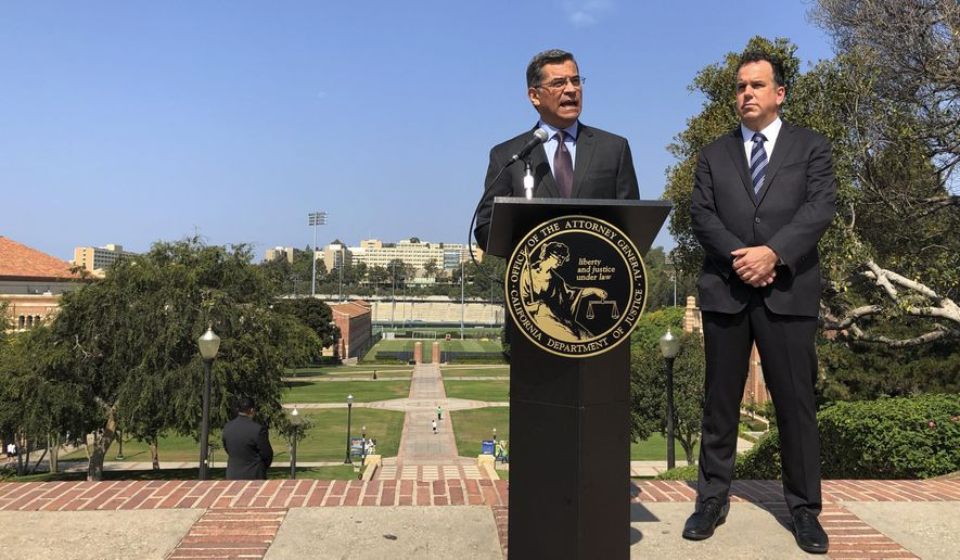 California Attorney General Xavier Becerra speaks at UCLA about his efforts to fight the Trump administration's proposal to weaken car efficiency fuel standards in Los Angeles on Thursday, Aug. 2, 2018. Deputy Attorney General David Zaft is on the right. (AP Photo/Brian Melley)