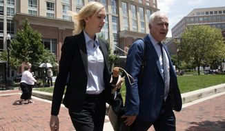 Paul Manafort's former bookkeeper Heather Washkuhn, left, walks to the Alexandria Federal Courthouse in Alexandria, Va., Thursday, Aug. 2, 2018, to testify at President Donald Trump's former campaign chairman Manafort's tax evasion and bank fraud trial. Washkuhn testified that Manafort kept her in the dark about the foreign bank accounts he was using to buy millions in luxury items and personal expenses. (AP Photo/Manuel Balce Ceneta)