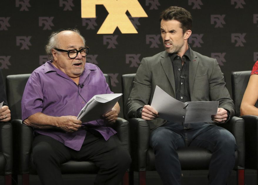 "Danny DeVito, left, and Rob McElhenney, creator/writer/executive producer/actor, participate in a table read during a panel for ""It's Always Sunny in Philadelphia"" during the FX Television Critics Association Summer Press Tour at The Beverly Hilton hotel on Friday, Aug. 3, 2018, in Beverly Hills, Calif. (Photo by Willy Sanjuan/Invision/AP)"