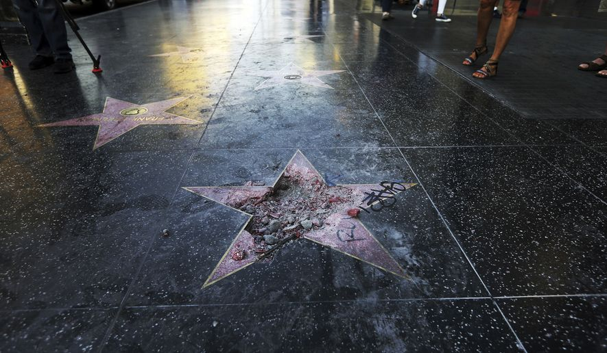 Donald Trump's vandalized star on the Hollywood Walk of Fame in Los Angeles. On Friday, Aug. 3, 2018.  (AP Photo/Reed Saxon)