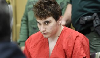 FILE - In this April 27, 2018 file photo, Florida school shooting suspect Nikolas Cruz, looks up while in court for a hearing in Fort Lauderdale, Fla. Attorneys for Cruz want a judge to prevent release of details of his education records to guarantee a fair trial. (Taimy Alvarez/South Florida Sun-Sentinel via AP, Pool, File)