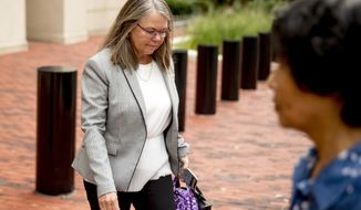 Tax preparer Cindy Laporta leaves the Alexandria Federal Courthouse in, Alexandria, Va., Friday, Aug. 3, 2018, on day four of President Donald Trump's former campaign chairman Paul Manafort's tax evasion and bank fraud trial. One of Manafort's tax preparers admitted Friday that she helped disguise $900,000 in foreign income as a loan in order to reduce the former Trump campaign chairman's tax burden. (AP Photo/Andrew Harnik)