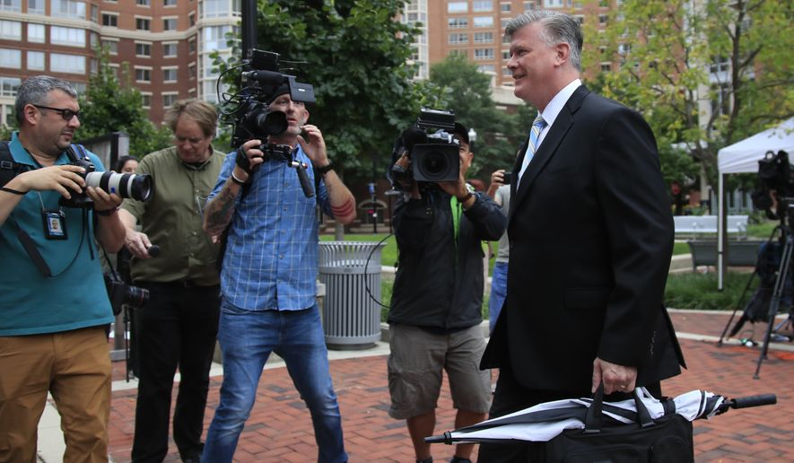 Kevin Downing, attorney for Paul Manafort, walks to the Alexandria Federal Courthouse in Alexandria, Va., Friday, Aug. 3, 2018, on day four of President Donald Trump's former campaign chairman Paul Manafort's tax evasion and bank fraud trial. (AP Photo/Manuel Balce Ceneta)
