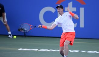 Andy Murray, of Great Britain, returns a shot to Kyle Edmund, of Great Britain, during the Citi Open tennis tournament, Wednesday, Aug. 1, 2018, in Washington. (AP Photo/Nick Wass) ** FILE **