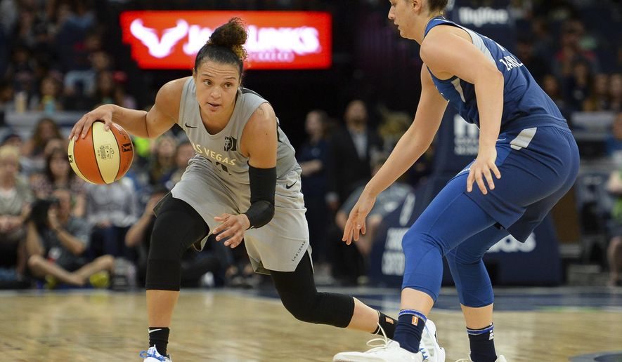 FILE - In this July 13, 2018, file photo, Las Vegas Aces guard Kayla McBride drives against Minnesota Lynx forward Cecilia Zandalasini (9) during the second half of a WNBA basketball game in Minneapolis. The Aces had an adventure getting to Washington for their game against the Mystics on Friday night. (Aaron Lavinsky/Star Tribune via AP, File)