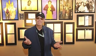 ADDS NO SALES-In this photo provided by the National Comedy Center, Saturday Night Live alum Dan Aykroyd stands in front of an exhibit of original SNL scrips and photos of the iconic show during a tour the National Comedy Center, Friday, Aug. 3, 2018, in Jamestown, N.Y. The new $50 million center, which is a museum dedicated to the art of comedy, features an array of artifacts and high-tech exhibits, including, holograms of comedians, both dead and alive. (Dan Cappellazzo/National Comedy Center via AP)