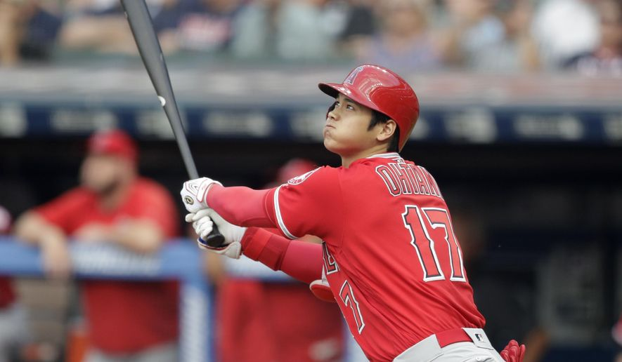 Los Angeles Angels' Shohei Ohtani watches his two-run home run off Cleveland Indians starting pitcher Mike Clevinger during the first inning of a baseball game Friday, Aug. 3, 2018, in Cleveland. (AP Photo/Tony Dejak)