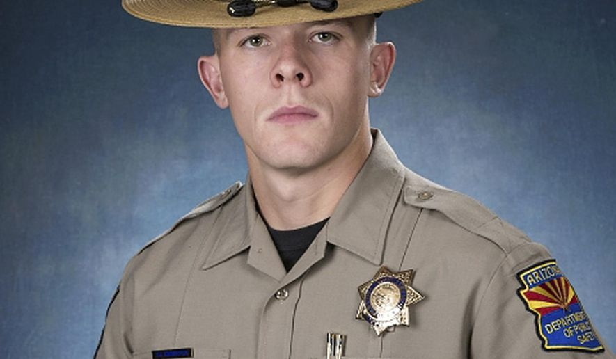 FILE - This undated file photo provided by the Arizona Department of Public Safety shows Arizona State Trooper Tyler Edenhofer. Friends and loved ones will bid farewell to 24-year-old Edenhofer, a rookie Arizona state trooper who was fatally shot in a struggle along an interstate, on Friday, Aug. 3, 2018, at a funeral service in a Peoria church. (Arizona Department of Public Safety via AP, File)