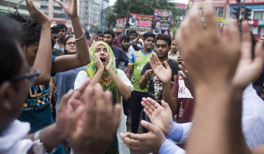 Bangladeshi students shout slogans as they block a road during a protest in Dhaka, Bangladesh, Thursday, Aug. 2, 2018. Students blocked several main streets in the capital, protesting the death of two college students in a bus accident in Dhaka. (AP Photo/A. M. Ahad)