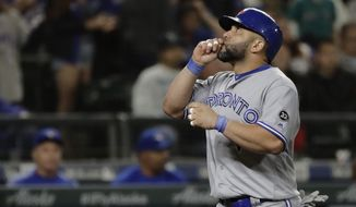 Toronto Blue Jays' Kendrys Morales looks up as the crosses the plate with a two-run home run against the Seattle Mariners during the seventh inning of a baseball game, Thursday, Aug. 2, 2018, in Seattle. (AP Photo/Ted S. Warren)