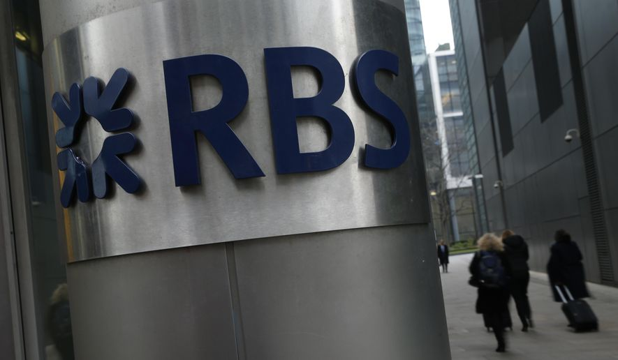 FILE - In this file photo dated Thursday, Jan. 26, 2017, People walk past one of the headquarters buildings showing the logo of the Royal Bank of Scotland (RBS) in London.  The Royal Bank of Scotland on Friday Aug. 3, 2018, announced a fall in second-quarter profit after being hit by a big charge from U.S. authorities, but the bank says it will pay its first dividend to shareholders in a decade. (AP Photo/Alastair Grant, FILE)