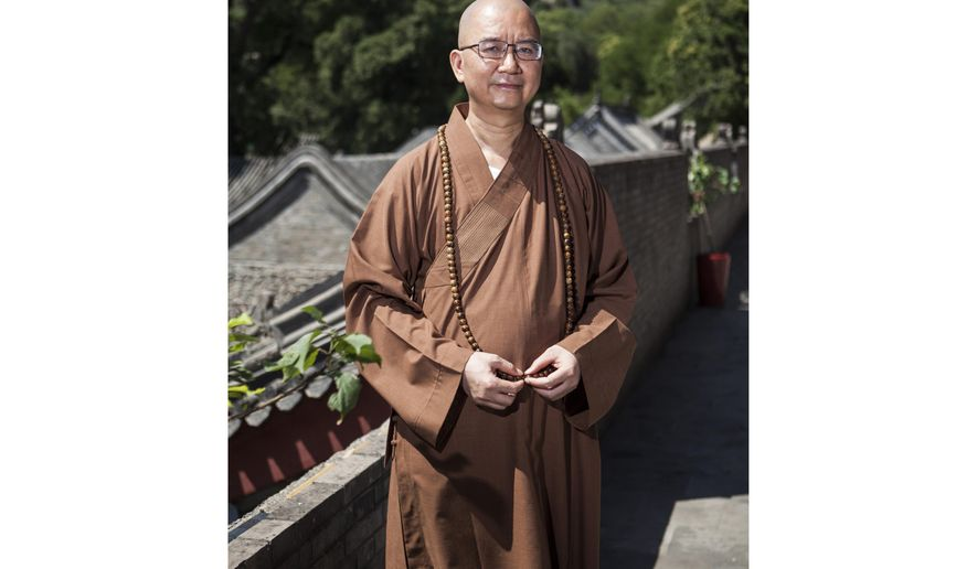 In this photo taken July 3, 2015, Abbot Xuecheng of the Beijing Longquan Temple poses for a photo at the temple in Beijing, China. Xue, one of China's highest-ranking Buddhist monks is facing a government investigation over accusations of sexual misconduct, in what is seen by some as an indication the #MeToo movement is gaining traction in the world's most populous nation. (Chinatopix via AP)