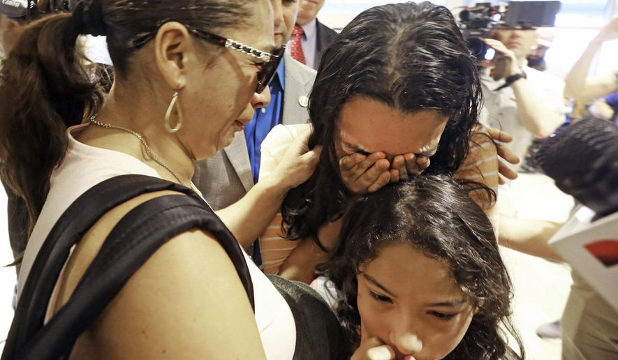 Alejandra Juarez, 39, left, says goodbye to her children, Pamela and Estela at the Orlando International Airport on Friday, Aug. 3, 2018, in Orlando, Fla.  Juarez, the wife of a former Marine is preparing to self-deport to Mexico in a move that would split up their family. (Red Huber/Orlando Sentinel via AP) ** FILE **