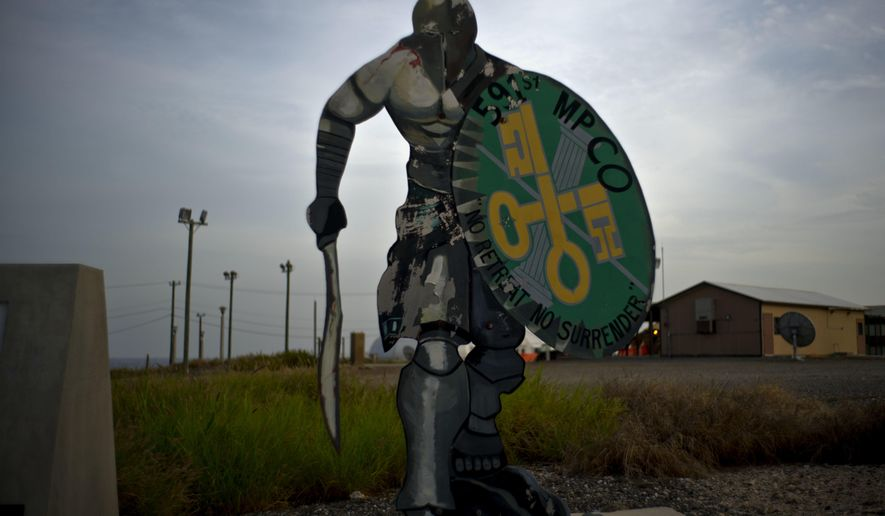 In this June 6, 2018 photo, an Iron Spartans statue stands on the Guantanamo Bay U.S. Naval Base in Cuba. The statue represents the 591st U.S. Military Police Company which was deployed at one time at the base. (AP Photo/Ramon Espinosa)