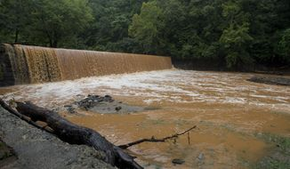 The Hollins Mill dam is overrun with water on Friday, Aug. 3, 2018 in Lynchburg, Va. The Hollins Mill dam, which is fed from College Lake Dam through the Blackwater Creek, flooded after a deluge of rain hit the city the night before.  (AP Photo/Jill Nance)