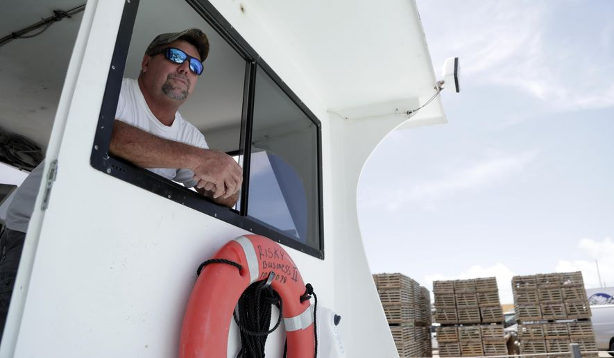 In this Monday, July 23, 2018 photo, lobster fisherman Ernie Piton looks out from his boat Risky Business in Key Largo, in the Florida Keys. Lobster fishermen in the Florida Keys fear a trade war with China could undermine storm recovery in the island chain. Lobsters are among the seafood and other U.S. goods hit by Chinese tariffs in early July, after the Trump administration put tariffs on billions of dollars' worth of Chinese goods. (AP Photo/Lynne Sladky)