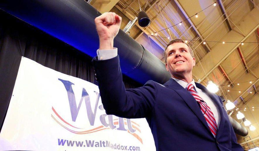 In this Tuesday, June 5, 2018 photo, Walt Maddox greets frenzied supporters at Tuscaloosa River Market after winning the Democratic Party's nomination for governor. Maddox on Tuesday, July 24, 2018 challenged Gov. Kay Ivey to a series of debates ahead of the election, saying that voters deserve to hear the next governor's answers for the state's problems. (Gary Cosby Jr./The Tuscaloosa News via AP)