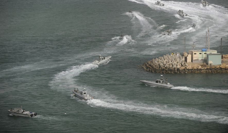 Iranian navy speed boats attend a drill in the sea of Oman, on Friday, Dec. 30, 2011.  Iran's navy chief has reiterated for a second time in less than a week that his country can easily close the strategic Strait of Hormuz at the mouth of the Persian Gulf, the passageway through which a sixth of the world's oil flows.  (AP Photo/IIPA, Ali Mohammadi)