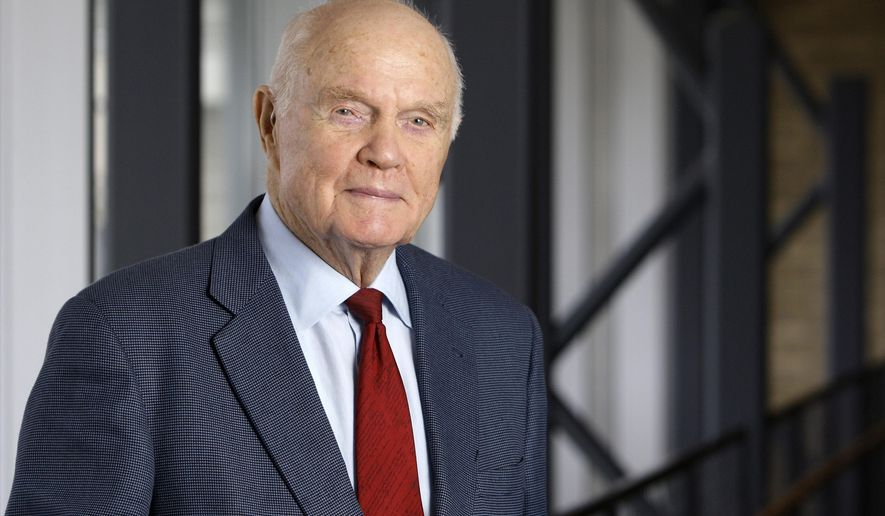 FILE - In this Jan. 25, 2012, file photo, former astronaut and Sen. John Glenn poses for a photo during an interview at his office in Columbus, Ohio.   A lengthy investigation by Air Force officials has concluded that the remains of Glenn were not treated disrespectfully at the Dover Air Force Base mortuary prior to his burial at Arlington National Cemetery last year. The Air Force launched a probe in May 2017 amid concerns that that inspectors who were visiting the facility had been invited to look at Glenn's remains, which they declined to do. (AP Photo/Jay LaPrete, File)
