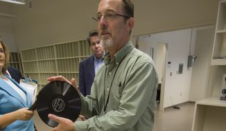 Eugene DeAnna, former director of the Recorded Sound Section, gives a tour of the new Library of Congress Packard Campus in Culpeper, Virginia. Here he shows off a 78 rpm record. (CQ Roll Call via AP Images)