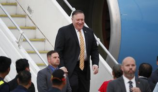 U.S. Secretary of State Michael Pompeo smiles as he arrives at the Subang military airport in Subang, Malaysia, Thursday, Aug. 2, 2018. Pompeo will meet senior Malaysian officials to discuss strengthening the Comprehensive Partnership and advancing common security and economic interests. (AP Photo/Vincent Thian)
