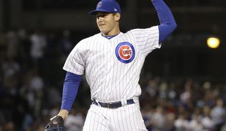 FILE - In this July 23, 2018, file photo, Chicago Cubs' Anthony Rizzo throws his first ever major league pitch in relief during the ninth inning of a baseball game against the Arizona Diamondbacks in Chicago. Pablo Sandoval made his debut on the mound this season. So have infielders Jose Reyes and Anthony Rizzo. The use of position players has become an increasing trend in baseball this season, especially in blowouts to save wear and tear on the bullpen. (AP Photo/Charles Rex Arbogast, File)