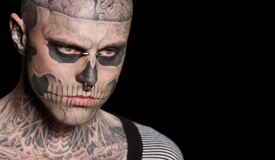 "FILE - In this Saturday, June 4, 2011 file photo, Canadian model Rick Genest, aka Zombie Boy, appears on the runway during a fashion show in Rio de Janeiro, Brazil. On Friday, Aug. 3, 2018, the agency that represents Genest, known for his head-to-toe tattoos and his participation in Lady Gaga music video ""Born This Way,"" says he has died. (AP Photo/Felipe Dana)"