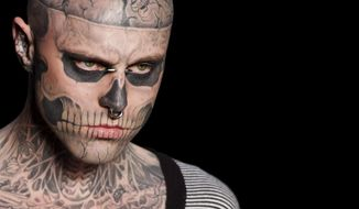 """FILE - In this Saturday, June 4, 2011 file photo, Canadian model Rick Genest, aka Zombie Boy, appears on the runway during a fashion show in Rio de Janeiro, Brazil. On Friday, Aug. 3, 2018, the agency that represents Genest, known for his head-to-toe tattoos and his participation in Lady Gaga music video """"Born This Way,"""" says he has died. (AP Photo/Felipe Dana)"""