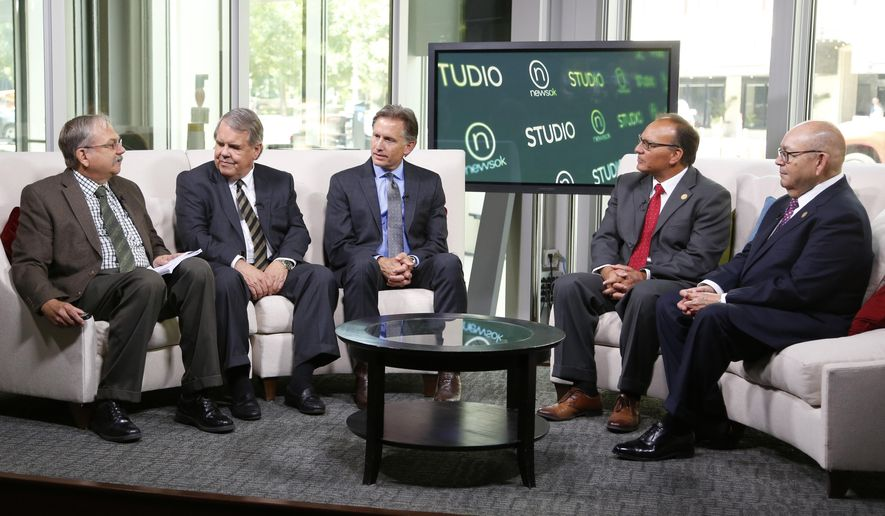 """Randy Ellis, from left, of The Oklahoman, Michael Burrage, attorney, Mike Hunter, Oklahoma attorney general, Gary Batton, chief of the Choctaw Nation and Gov. Bill Anoatubby, Chickasaw Nation, attend a panel discussion on opioid lawsuits on the set of NewsOK.com, Friday, Aug. 3, 2018, in Oklahoma City. A lawsuit by the state of Oklahoma against the makers of opioids is going back to state court per U.S. District Judge Vicki Miles-LaGrange's ruling Friday that the lawsuit does not """"necessarily raise"""" a federal issue. (Doug Hoke/The Oklahoman via AP)"""
