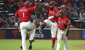 Texas Rangers' Elvis Andrus (1) and Rougned Odor (12) celebrate Odor's two-run home run against the Baltimore Orioles during the sixth inning of a baseball game Thursday, Aug. 2, 2018, in Arlington, Texas. (AP Photo/Richard W. Rodriguez)