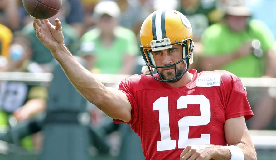 Green Bay Packers quarterback Aaron Rodgers (12) throws during a practice at NFL football training camp, Tuesday, July 31, 2018 at Ray Nitschke Field in Ashwaubenon, Wis. (Jim Matthews/The Post-Crescent via AP)