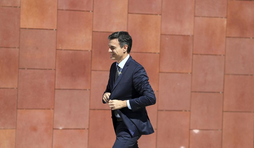 Spanish Prime Minister Pedro Sanchez arrives to meet Portuguese Prime Minister Antonio Costa prior to a Summit for Energy Interconnections at the European Maritime Safety Agency headquarters in Lisbon Friday, July 27, 2018. (AP Photo/Armando Franca)