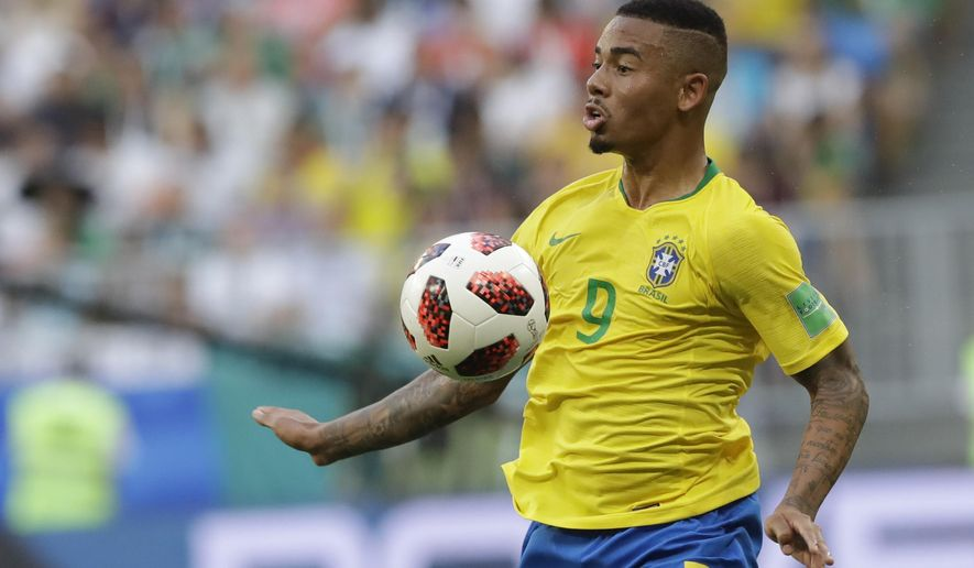 FILE - In this file photo dated Monday, July 2, 2018, Brazil's Gabriel Jesus controls the ball during the round of 16 match between Brazil and Mexico at the 2018 soccer World Cup at the Samara Arena, in Samara, Russia. Brazil forward Gabriel Jesus extended his Manchester City contract on Friday Aug. 3, 2018, to 2023, adding two more years to his previous deal. (AP Photo/Andre Penner, FILE)