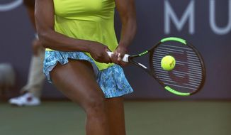 Venus Williams, of the United States, returns the ball to Heather Watson, from Britain, during the Mubadala Silicon Valley Classic tennis tournament in San Jose, Calif., Thursday, Aug. 2, 2018. (AP Photo/Tony Avelar)