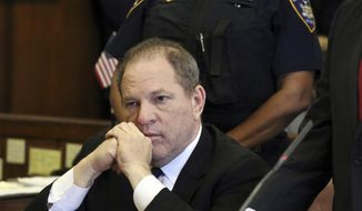 """FILE - In this July 9, 2018 file photo, Harvey Weinstein attends his arraignment in court, in New York.  Weinstein's lawyers want a New York court to throw out sexual assault charges against him. Lawyers for the former movie titan-turned-#MeToo villain filed notice Friday, Aug. 3, they'll seek dismissal of the case. Among other arguments, they say the grand jury that indicted Weinstein should have been told about emails from one of his three accusers: a woman who said he raped her in 2013. One message, less than a month after the alleged attack, expresses appreciation for """"all you do for me."""" Another, days later, says """"it would be great to see you again."""" (Jefferson Siegel/The Daily News via AP, Pool, File)"""