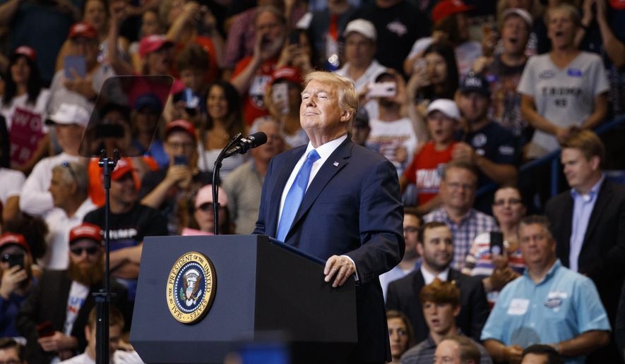 President Donald Trump pauses during a rally, Thursday, Aug. 2, 2018, at Mohegan Sun Arena at Casey Plaza in Wilkes Barre, Pa.. (AP Photo/Carolyn Kaster)