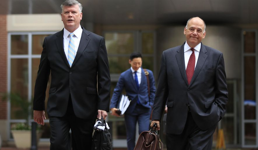 Kevin Downing, left, and Thomas Zehnle, attorneys for Paul Manafort, walk to the Alexandria Federal Courthouse in Alexandria, Va., Friday, Aug. 3, 2018, on day four of President Donald Trump's former campaign chairman Paul Manafort's tax evasion and bank fraud trial. (AP Photo/Manuel Balce Ceneta)
