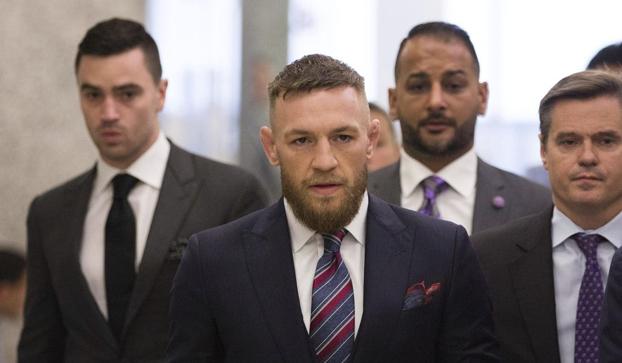 FILE - In this July 26, 2018, file photo, mixed martial arts fighters Conor McGregor leaves the courthouse following a hearing in New York. McGregor will return to mixed martial arts on Oct. 6 in Las Vegas with a bout against UFC lightweight champion Khabib Nurmagomedov. The UFC dramatically announced the matchup Friday, Aug. 3, to close a news conference promoting the slate of fight cards for the rest of 2018. (AP Photo/Kevin Hagen, File)