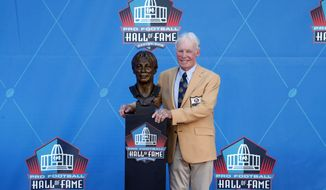 NFL contributor Bobby Beathard poses with a bust of himself during an induction ceremony at the Pro Football Hall of Fame, Saturday, Aug. 4, 2018, in Canton, Ohio. (AP Photo/Gene J. Puskar) ** FILE **