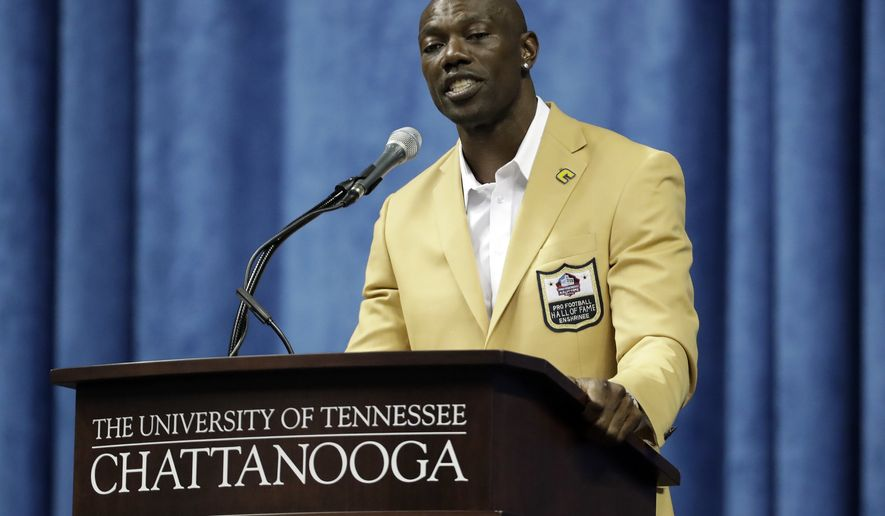Former wide receiver Terrell Owens delivers his Pro Football Hall of Fame speech on Saturday, Aug. 4, 2018, in Chattanooga, Tenn. Instead of speaking at the Hall of Fame festivities in Canton, Ohio, Owens celebrated his induction at the University of Tennessee at Chattanooga, where he played football and basketball and ran track. (AP Photo/Mark Humphrey)