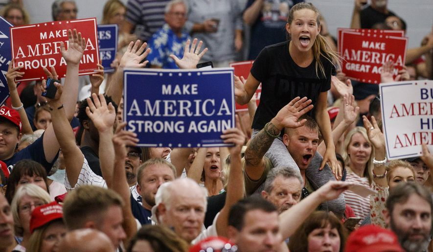 The crowd cheers toward the media in the overflow room before President Donald Trump arrives to speak at a rally at Olentangy Orange High School in Lewis Center, Ohio, Saturday, Aug. 4, 2018. (AP Photo/Carolyn Kaster) ** FILE **