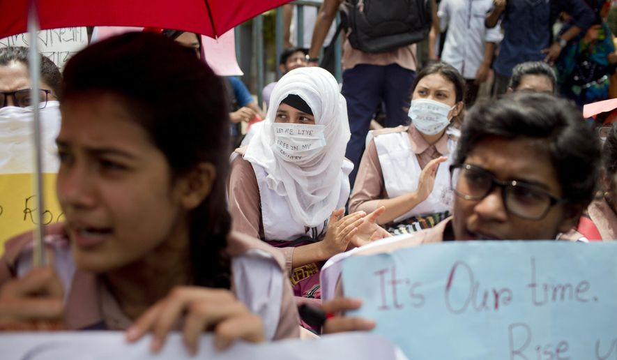 Bangladeshi students participate in a protest in Dhaka, Bangladesh, Saturday, Aug. 4, 2018. Five days of protests by tens of thousands of students angry over the traffic deaths of two of their colleagues have largely cut off the capital Dhaka from the rest of Bangladesh, as the demonstrators pressed their demand for safer roads. (AP Photo/A. M. Ahad)