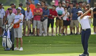 Dustin Johnson watches his approach on the 13th hole during the second round of the Bridgestone Invitational golf tournament at Firestone Country Club, Friday, Aug. 3, 2018, in Akron, Ohio. (AP Photo/David Dermer)