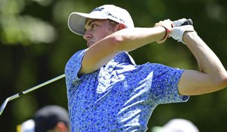 Justin Thomas watches his tee shot on the fifth hole during the third round of the Bridgestone Invitational golf tournament at Firestone Country Club, Saturday, Aug. 4, 2018, in Akron, Ohio. (AP Photo/David Dermer)