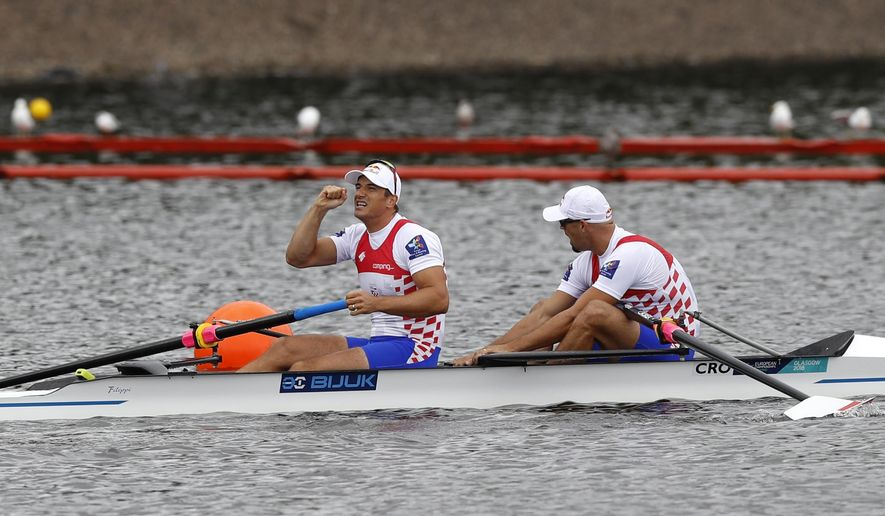 Martin Sinkovic, right, and Valent Sinkovic of Croatia react after winning the Men's Pair race final at the European Rowing Championships in Glasgow, Scotland, Saturday, Aug. 4, 2018. (AP Photo/Darko Bandic)