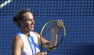 Svetlana Kuznetsova, of Russia, responds to the crowd after defeating Andrea Petkovic, of Germany, during the semifinals of the Citi Open tennis tournament in Washington, Saturday, Aug. 4, 2018. Because of rain delays, Kuznetsova had to play two matches on Saturday. She won both and advanced to the finals. (AP Photo/Susan Walsh) **FILE**