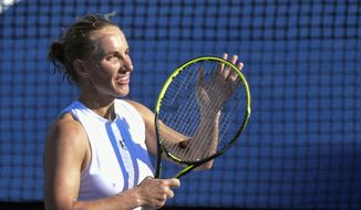 Svetlana Kuznetsova, of Russia, responds to the crowd after defeating Andrea Petkovic, of Germany, during the semifinals of the Citi Open tennis tournament in Washington, Saturday, Aug. 4, 2018. Because of rain delays, Kuznetsova had to play two matches on Saturday. She won both and advanced to the finals. (AP Photo/Susan Walsh)