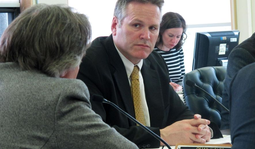FILE - In this, May 17, 2016, file photo, Alaska state Sen. Mike Dunleavy listens during a Senate Finance Committee meeting in Juneau, Alaska. Dunleavy and Mead Treadwell are vying to become the third person in what is shaping up to be a three-way fight for governor in Alaska. The winner of the Aug. 21 GOP primary will advance to the general election. (AP Photo/Becky Bohrer, File)