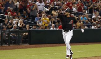 Arizona Diamondbacks' David Peralta points to the crowd as he rounds the bases after hitting a home run against the San Francisco Giants during the second inning of a baseball game Friday, Aug. 3, 2018, in Phoenix. (AP Photo/Ross D. Franklin)